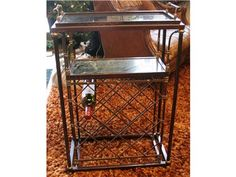 Wine rack. Removable serving tray. Marble insert. Can hold 13 bottles of wine. Made of metal.