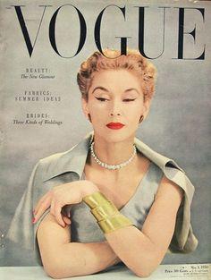 Vogue 1950. Note the cat's eye eyeliner. Cool bracelet.