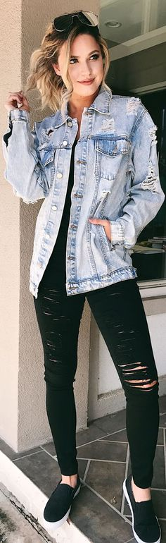 what to wear with a denim jacket : black ripped jeans and sneakers