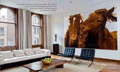 Wild Horses of Sable Island art in NYC apartment. Big windows. Big art. Barcelona chairs.