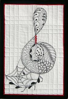 A zentangle mini quilt, by Pat Ferguson.  This looks more like my speed, small and fun.