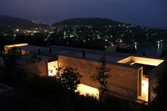 Built by Pilar Garcia, Carolina Portugueis, Martin Labbe in Zapallar, Chile The house is located in the north hillside of Zapallar's bay, on the coastal way, in an area with a slope of 30 %. Th...