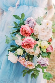 """From the editorial """"Apulian Charm and Italian Ease, This Idyllic Inspiration at Masseria Montenapoleone Is a Must-See!"""" Between that bright blue @elizabethdye gown, epic bloom installations from @flower_addicted_angelica, and towering floral cake by @pavlovs_lab, there's endless amounts of pretty to fall in love with!   Photography: @andreaskgeorgiou Wedding Bridesmaid Bouquets, Blue Wedding Gowns, Wedding Reception Flowers, Spring Wedding Flowers, Wedding Flower Arrangements, Floral Wedding, Wedding Ideas, Dream Of Getting Married, Inspiration"""