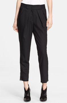Free shipping and returns on Yigal Azrouël Pinstripe Stretch Wool Pants at Nordstrom.com. Diagonal pleats below a wide banded waist lend on-trend, avant-garde volume to tapered stretch-wool pants patterned with classic pinstripes. Shiny ankle zippers reinforce the modern design.