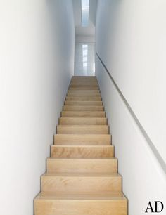 stairs float off the walls, hand rail is recessed into walls