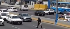 Cop Crosses 5 Lanes Of Traffic To Rescue Frightened Puppy In Peru