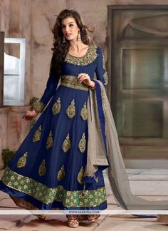 Add the feel of feminine elegance by this blue georgette and net anarkali salwar kameez. The ethnic embroidered, lace and resham work over a attire adds a sign of elegance statement with your look. Co...