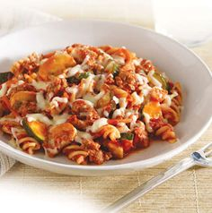 Packed with zucchini, mushrooms and carrots, the kids will never know they're eating their vegetables - and loving them - in this Spicy Italian Pasta Bake with Hunts and Pam from Seasons.