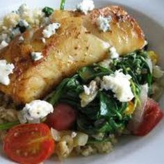"""Greek Tilapia over Wilted Spinach """"Perfectly delicate and tender, tilapia prepared this way is likely to win over even the pickiest of eaters."""""""