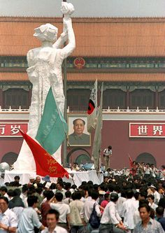 May 30, 1989: Chinese demonstrators gather by the 'Goddess of Democracy' statue at Tiananmen Square in Beijing after it is unveiled for the first time.