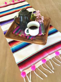 A personal favorite from my Etsy shop https://www.etsy.com/listing/453403470/mexican-serape-table-runner-with-pompom