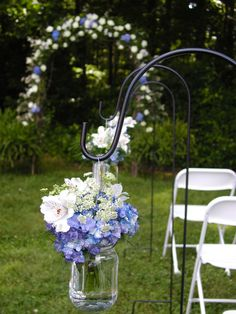 I loved the Arbor with the Blue and White then The Mason Jars on the Asile with the blue and White.  Beautiful!  Winding Creek Farm and Wedding Barn in Hamptonville, NC