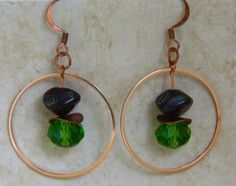 Red and Green hoop earrings. Fabulously stylish, these earrings feature gorgeous red Czech glass Picasso beads and accented green crystals. There are curved copper spacers in between the Czech beads a
