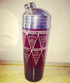 Vintage cocktail shaker:  Here we've got one more beautiful Ruby Glass Cocktail shaker with some 16 Drink recipes to mix. Very crisp silkscreen print. The lid has a patent date from 1935. Very cool piece ..