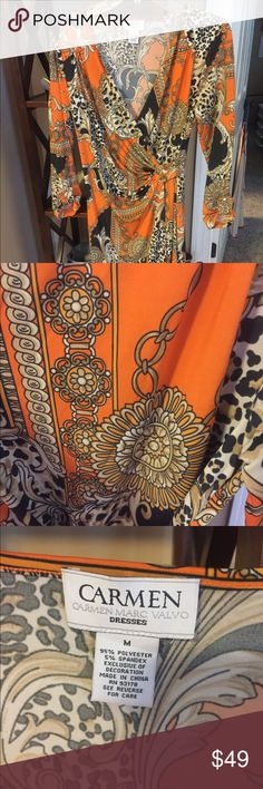 Carmen Marc Valvo dress Orange and black designer dress would make a great addition to your fall closet. The dress is knee length with a buckle in the front. Carmen Marc Valvo Dresses