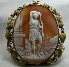 """Cameo: Amazon, ca. 1840/50 Material: Sardonyx Shell,  9 and 15K gold tested, seed pearls. Size: 2 6/8"""" by just under 2 1/2"""" cameo only is 2 3/8"""" by 1 7/8"""". Date and Origin: Circa 1840/1850 Italy, frame could be English. - See more at: http://theebonswan.blogspot.com.es/2013/09/cameo-amazon-ca-184050.html#sthash.kFNiWTjb.dpuf"""