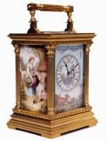 A French carriage clock mounted with porcelain panels showing rural scenes.