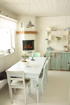 love the little fireplace in the corner of the kitchen
