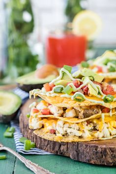 Loaded Breakfast Tostada Stacks! These fun and crispy breakfast tostadas are loaded with egg, cheese, sausage, and avocado! Makes for perfect mornings!