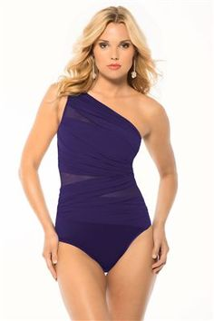 slimming asymmetrical one piece with shelf bra and mesh cut outs.