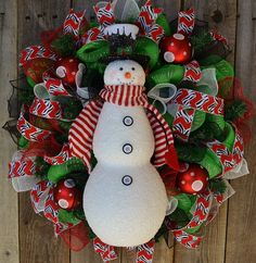 Snowman Christmas Wreath!  Snowman with top hat and striped scarf holding a red heart.  Zebra stripe Christmas ribbon, mesh christmas wreath - pinned by pin4etsy.com