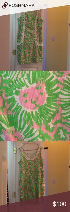 Lilly Pulitzer shift dress size 12 This dress is in one of my favorite prints! It has pockets and is in great condition. It's great for weddings and classy events! Lilly Pulitzer Dresses