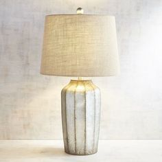 For fans of the French farmhouse (show of hands!), our Galvanized Table Lamp's a beauty with its aged gunmetal gray finish. Topped with a genuine linen shade, casual country becomes <i>tres chic</i>.