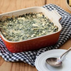 A riff on traditional spinach artichoke dip, this creamy, cheesy dip recipe is made healthier by replacing some of the cream cheese with yogurt. Serve as an easy appetizer with tortilla chips and carrot sticks.