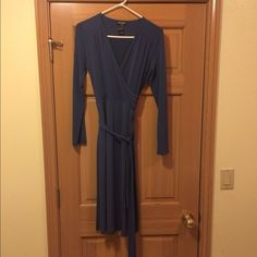 "BCBG beautiful wrap dress. Women's size small BCBG wrap dress. Comes with a tie belt. 96% polyester and 4% spandex. Beautiful dress that is in excellent condition. I am 5'8"" and it looks like it would hit me at mid calf.  Beautiful medium blue color. BCBG Dresses Long Sleeve"