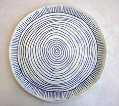 Image of hand drawn blue and white porcelain plate
