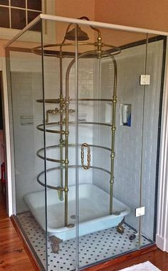 """A very nice all brass Standard ribcage needle shower on 42"""" claw legged base. Offered by owner who bought from me over 15 years ago. In Raleigh NC. Price is $15,000. Vintage Plumbing Bathroom Antiques - Toilets, Showers, & Etc."""