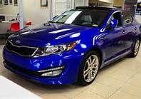 metallic blue kia optima, this is Valentina's car from Pandamonium.