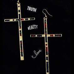 Colorful Rhinestone cross earrings. Fashion earrings, with a blinged out cross, for that hip hop or any other looks.....as long as it's sexy Jewelry Earrings