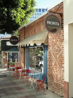 Blue window frame and red chairs. Profeta coffee shop in Westwood