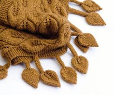 Whimsical, dreamy, feminine knit wrap with leafy lace pattern and dangling leaves. It can be worn as a wrap, a shawl or as a scarf. Its lightweight and
