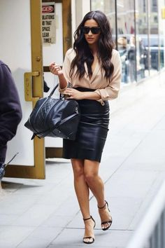 Shay Mitchell wearing Givenchy Quilted Medium Lucrezia Duffel, Theperfext Amsterdam High Waisted Leather Skirt and Piece the Oxford Bodysuit in Nude