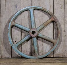 A large and heavy antique steel wheel with a great industrial rustic look Salvaged from an old barn in Lancaster County PA and ready to find a good new home and be re purposed with a fun new life Large and heavy measuring at approx 18 wide, with the hole in the middle being 1 3/8