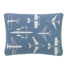 Flight Knitted Boudoir Pillow   The Flight nursery collection was inspired by the clean lines and bold graphics of mid-century aviation posters. The sky blue and grey palette with pops of orange makes this design an instant classic just right for the nursery.