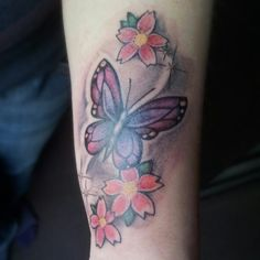 Claudia her new and lovely butterfly and flowers wrist tattoo.