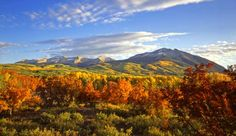 The Rocky Mountains are the most spectacular mountains in US outside of Alaska. The best place to photograph them is in Rocky Mountain National Park in Colorado. The best time of year would be in the fall to capture the full colors of the aspen trees.