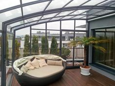 Siting set and some kind of plant covered by our superb terrace enclosure CORSO.