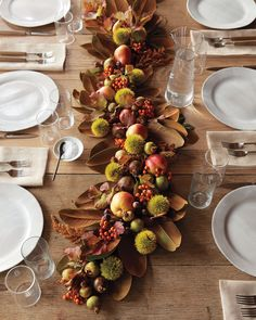 Craft a freeform garland (no wires required!) from fruits leaves and dried flowers. To keep the garland fluid and casual we gently snaked it down the table rather than setting it down in a straight rigid fashion. Thanksgiving Table Settings, Thanksgiving Centerpieces, Holiday Tables, Apple Garland, Fall Garland, Deco Nature, Autumn Table, Elegant Centerpieces, Magnolia Leaves