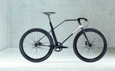 Coren - the urban carbon bike by UBC GmbH, Germany. Constructed in 40 hours from very high tensile strength T1000 carbon fibres. 7.7kg. Very VERY expensive at €25,000