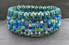 Blue, gold and green safety pin bracelet Safety Pin Bracelet, Organza Gift Bags, Handmade Jewellery, Blue Gold, Turquoise Bracelet, Glass Beads, Jewelry Making, Bracelets, Green