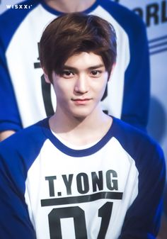 Taeyong. Oh my days... I just realised what it says on his shirt