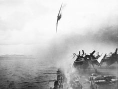 7 Anti-aircraft gunners, center foreground, pour a deadly stream of fire into an already-burning Japanese Kamikaze plane plummeting toward the flight deck of the USS Sangamon, a Navy escort carrier, during action in the Ryukyu Islands near Japan, on May 4, 1945. This suicide plane landed in the sea close to the carrier. Another Japanese aircraft later succeeded in hitting the ship deck, inflicting heavy damage. (AP Photo/U.S. Navy) #
