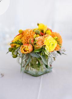 Simple orange arrangement. Floral Design: Daisy Rose Flowers.  Photography: Em The Gem - emthegem.com  Read More: http://www.stylemepretty.com/2014/07/30/classic-vineyard-wedding-with-a-pop-of-color/