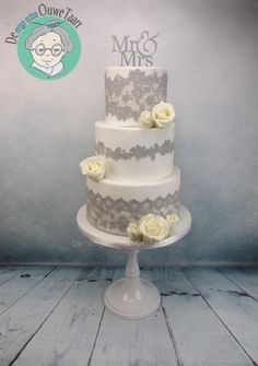 Wedding cake with gray cake lace and modeling chocolate roses - Cake by DeOuweTaart