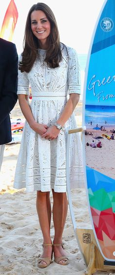 Kate hit Sydney's beach in an aptly breezy LWD. April 18, 2014