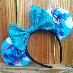 Handmade Disney inspired Lilo & Stitch Minnie Mickey Mouse ears.  + Comfy padded ears.  + These ears fit age 5 to adult, if needed for a toddler please leave a note in comments box at your check out and Ill make sure use a small band. +++All my ears are handmade by me to ensure quality, no two items are exactly identical.  + If there is something you would like me to change on the ears please feel free to message me for any questions or requests.  +++++ All ears are handmade to order…